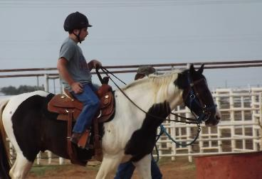 This rider was a buckle winner at the Roosevelt County Fair. He had regular lessons through out the year to prepare.